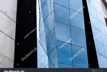 stock-photo-valencia-spain-march-facade-of-a-modern-glazed-building-where-workers-conduct-1672073623